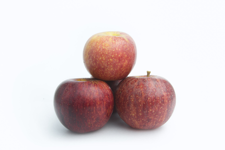 Three red apple isolated with white background.