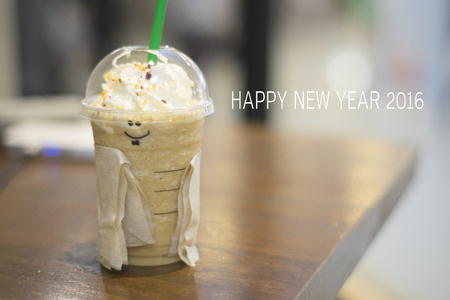 Happy new year 2016 with smile  ice coffee cup.
