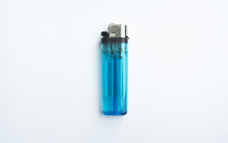 Used blue lighter isolated with white background. Archivio Fotografico