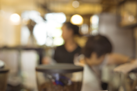 People on coffee shop background blur with bokeh.