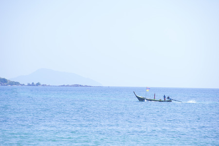 A man on a boat in the sea.