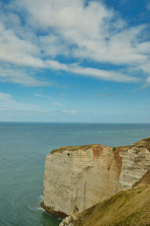 Alabaster coast of Normandie, France with English Channel in background, blue sky