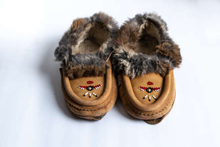 A pair of Indigenous-made, beaded rabbit fur moccasin slippers in Southwestern Ontario, Canada.