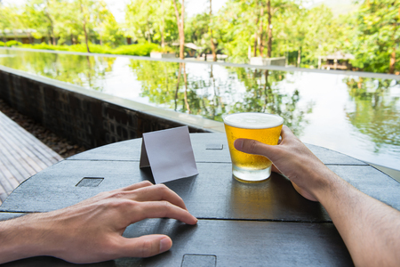 yellow notepad: Relax time with glass of beer at natural resort. Stock Photo