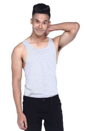 handsom: Tan Skin Asian black hair, handsom muscle good looking man in gray vest black pant jean, stand pose in studio lighting white background, hand on neck