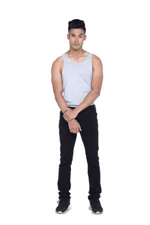 handsom: Tan Skin Asian black hair, handsom muscle good looking man in gray vest black pant jean, stand pose in studio lighting white background
