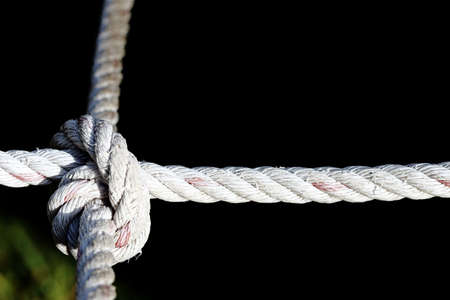 cut through the maze: Nylon Rope Knot four ways, difficult hard to solve, black background