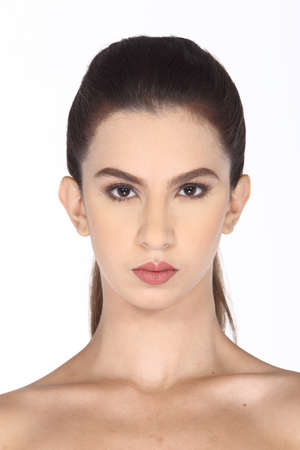 hair do: Caucasian Woman after make up hair do. no retouch, fresh face with acne then cosmetic foundation by professional artist in studio lighting white background