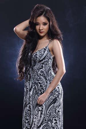 love blow: Beautiful Asian Girl in Glitter, Snowflake and Smoke in Dark background, half body portrait, lady black hair in pattern dress