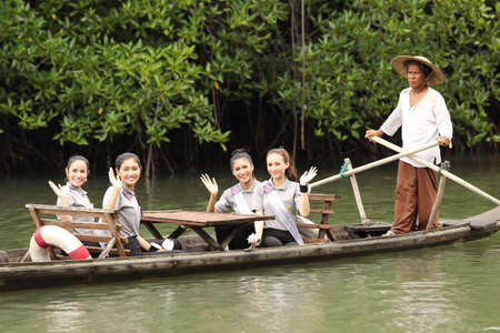 chang: Bangkok, Thailand - July 4, 2017 ; Camping Outting Trip of Miss Tourism Queen Thailand 2017 at Koh Chang, Trat. Activity travel by boat to Mangrove Intertidal forest to see source of life Editorial