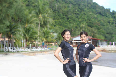 chang: Bangkok, Thailand - July 5, 2017 ; Camping Outting Trip of Miss Tourism Queen Thailand 2017 at Koh Chang, Trat. Sefety Swim wear on the beach resort Editorial