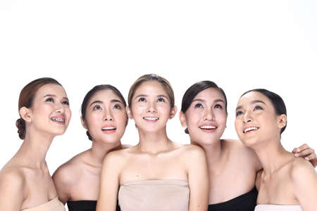 close up: Group of Five Beautiful Women with fashion clean make up wrap hair, open shoulders, studio lighting white background isolated copy space Stock Photo