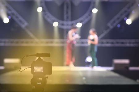 vdo: Video DSLR Camera social media network live recording on interview session of contest on stage ramp with lighting moving Stock Photo