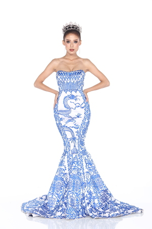Full Length of Miss Pageant Contest in graphic blue Evening Ball Gown long dress with Diamond Crown, fashion make up hair style, studio lighting white background isolated
