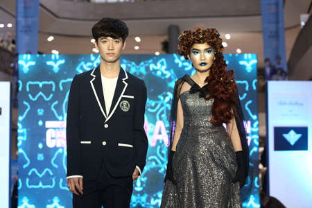 hairdresser: Bangkok, Thailand - August 11, 2017 ; Hair Fashion Show from Chalachol Academy, presenting hair design on catwalk stage in Central Department Store, both man and woman style with gown dress Editorial