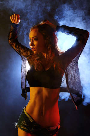 marketing online: Sexy Nice Body Caucasian Woman in black net jacket short jeans pant, back light with smoke black background, Stock Photo