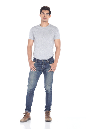 Tan Skin Asian black hair, handsome muscle good looking man in grey t shirt jean pant brown shoes, stand pose in studio lighting white background, male model Stock Photo