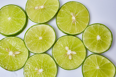 vesicles: Limes sliced on white background Stock Photo