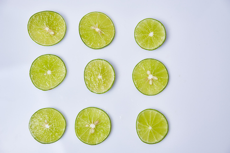 Limes sliced on white background Stock Photo