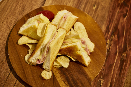 jamon y queso: Sandwiches ham cheese on wood background