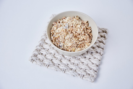 malted: Whole grain oat flakes, Cornflakes on white background