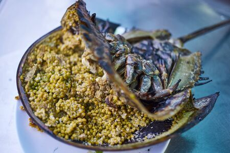 Grilled horseshoe crab eggs prepare for serve with spicy salad