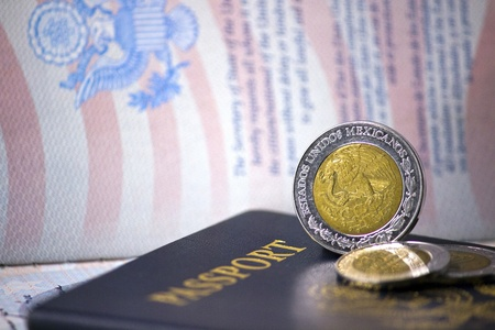 foreign nation: U S  Passports with Mexican Coins Editorial