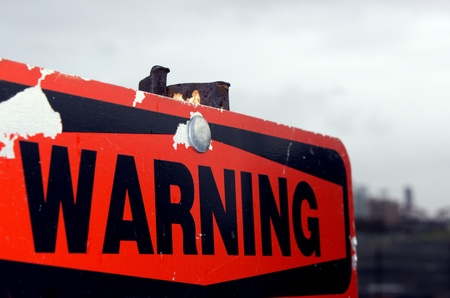 hazard sign: Old Warning Sign Stock Photo