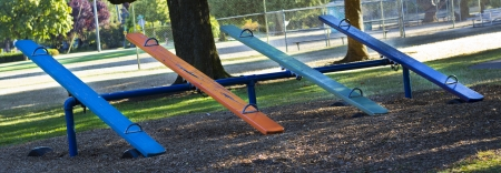 see saw: Multi colored teeter totter Stock Photo