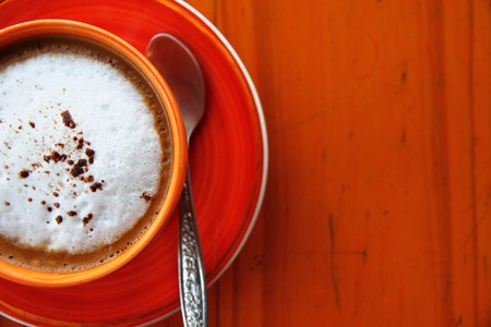A cup of coffee with spoon photo