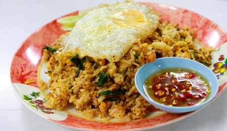 Tomyum fried rice and fried egg with fish-sauce