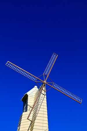 Windmill in the park at Chiangrai, Thailand Stock Photo