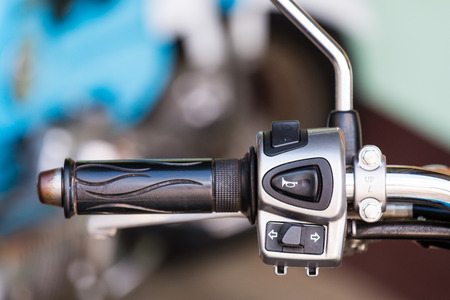 The control button on motorcycle handlebar.