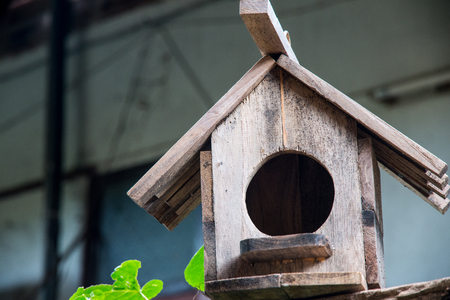 Old wooden birdhouse.