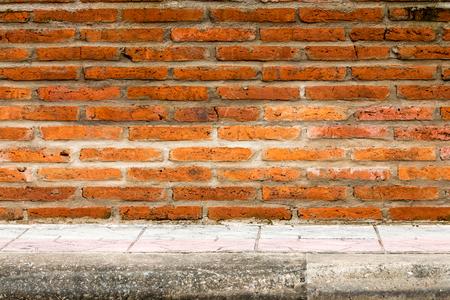 Brick wall and footpath