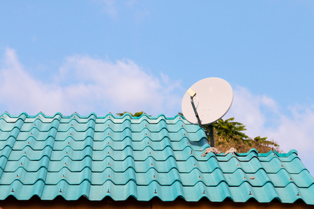A white dish on the blue roof in the north of Thailand Stock Photo