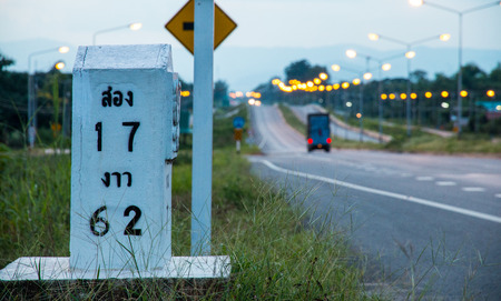 Milestone on the road to Song, Phrae, Thailand.