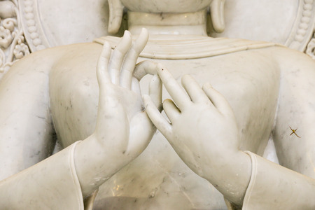 Hand of white marble buddha in Wat Phare tam ma ram (Tam ma ram temple), Phrae, Thailand. Stock Photo