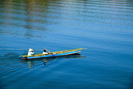Two people on a Thai paddle boat.