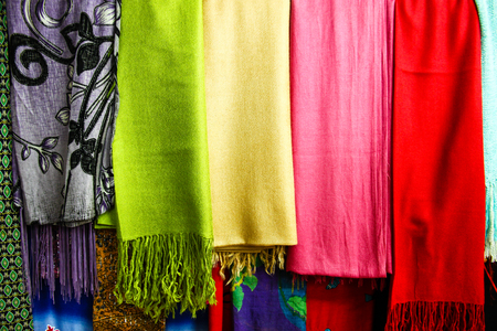beautiful thai silk scarves selling on a local asian market in Thailand.