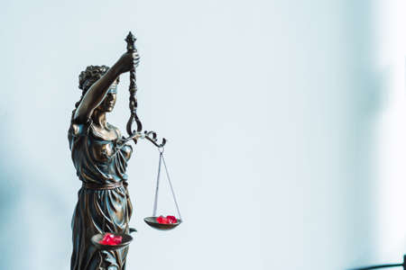 statue of justice inside a lawyer office