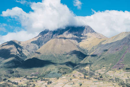 Imbabura Volcano situated in the north of ecuador with a beutiful blue sky in the background with some clouds