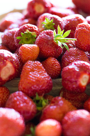 grocer: A lot of fresh and red strawberries collected together