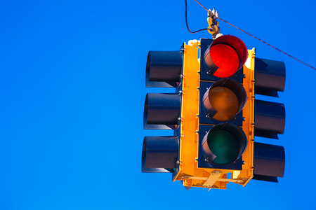 trafficlight: A red traffic signal with a sky blue background Stock Photo