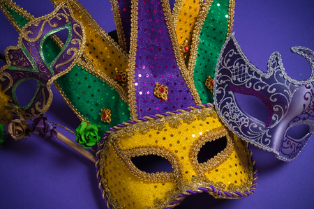 carnivale: Mardi Gras or carnival mask on bright purple background