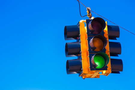 trafficlight: A green traffic signal with a sky blue background