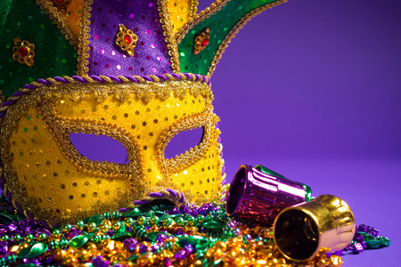 carnivale: Festive Grouping of mardi gras, venetian or carnivale mask on a purple background