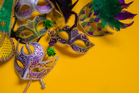 disguise: A venetian, mardi gras mask or disguise on a yellow background Stock Photo