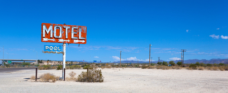 Old, abandoned motel sign in the dessert on Route 66
