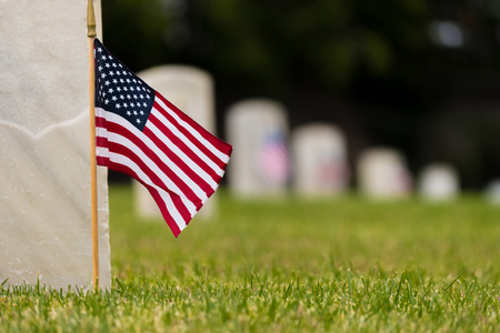 Small American flags and headstones at National cemetary- Memorial Day display Stock Photo